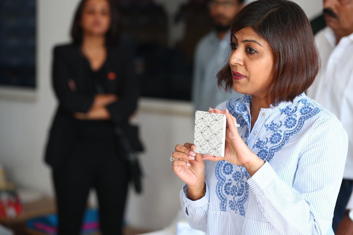 Nupur Bordia explaining the process and making of blue pottery