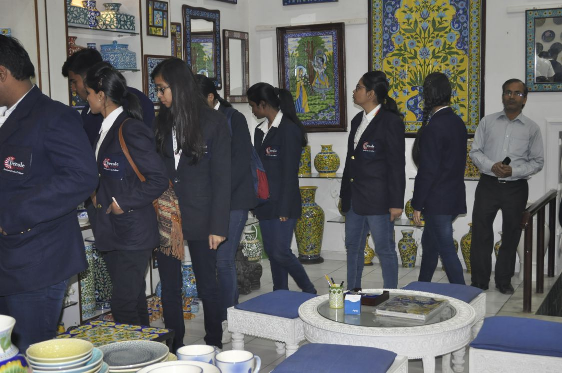 students entertaining themselves in blue pottery showroom
