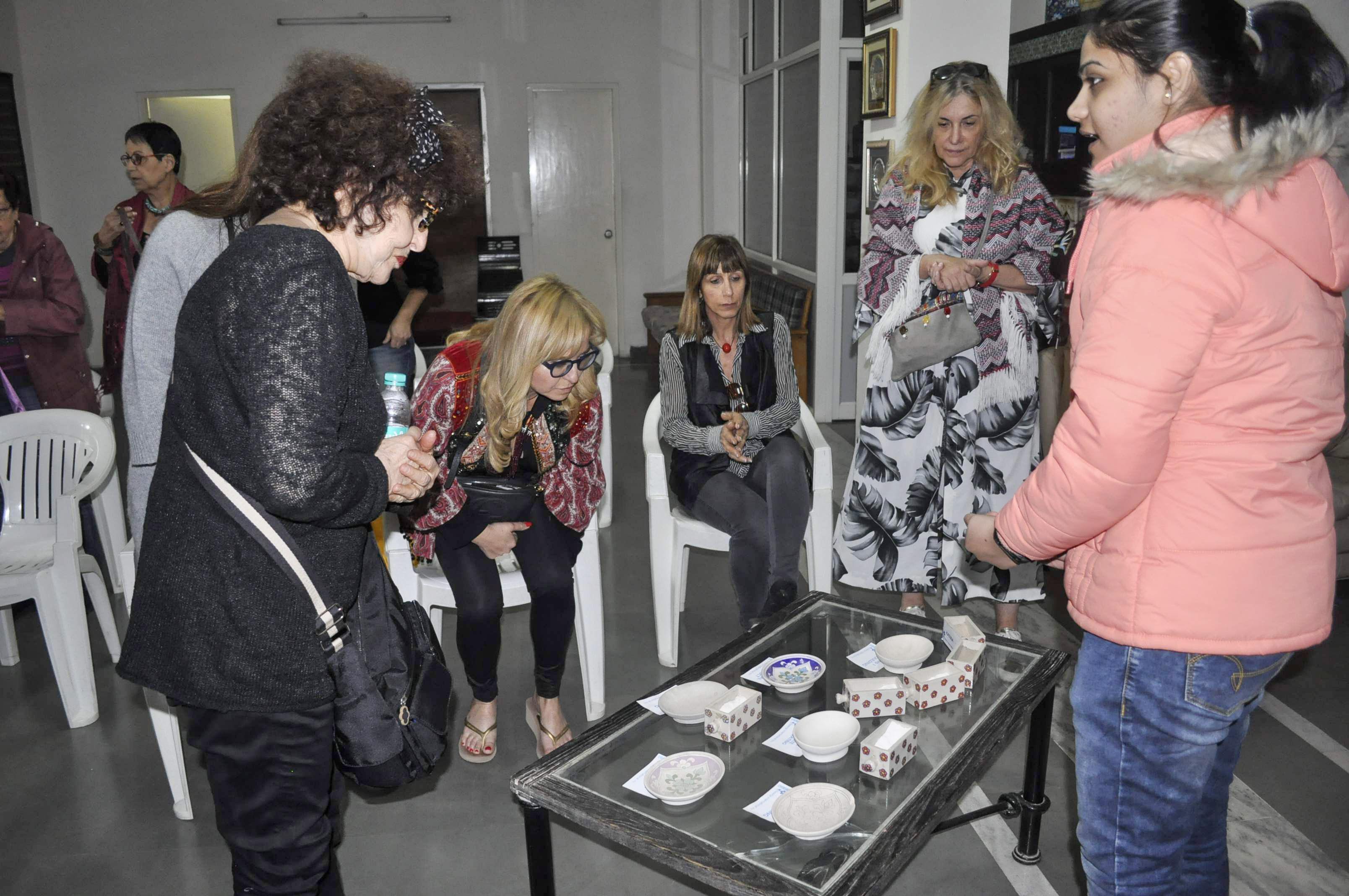 Neerja coordinator explaining the blue pottery process