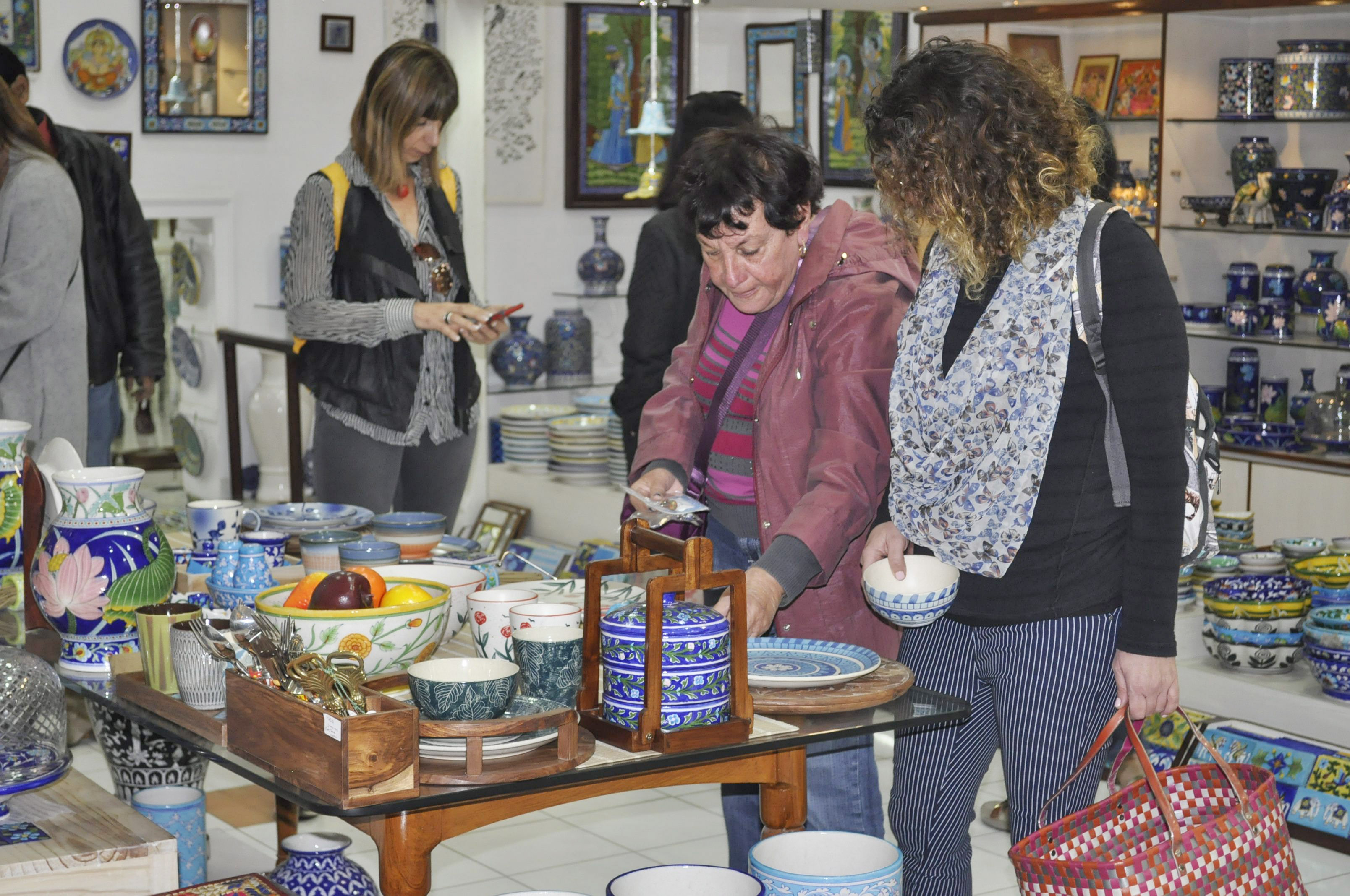 The group engaged themselves while shopping for blue pottery articles 01