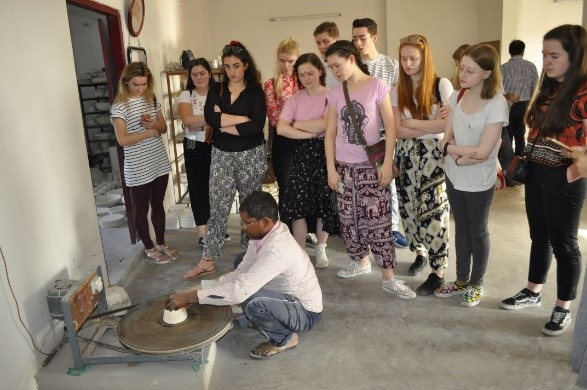 The students and the faculty were happy to see the artisans working on the potter's wheel.