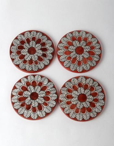White Leafy Design on Red Coasters