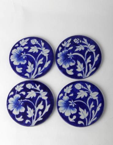 White Floral Design on Blue Coasters